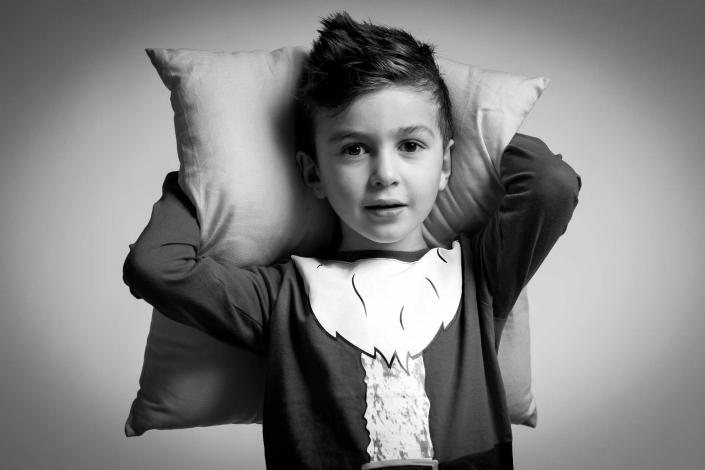 ritratto fotografico, bambino con cuscino