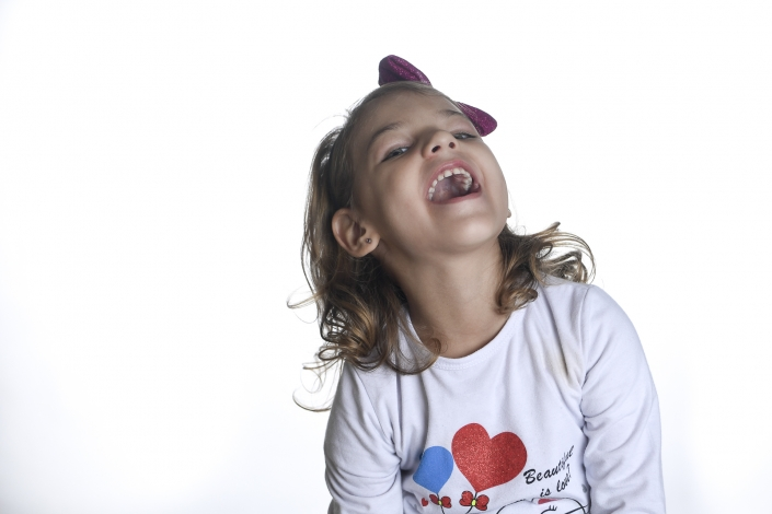 fotografo famiglia, bambina che sorride